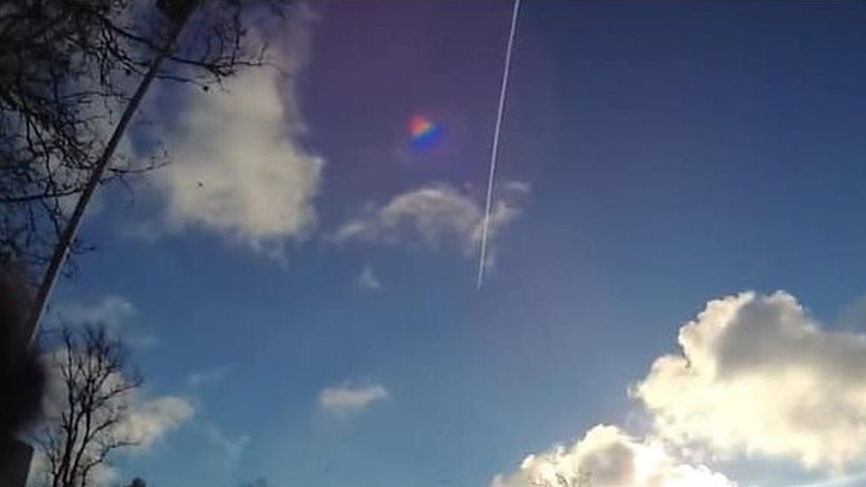 An image from a police officer's body-worn camera showing the RAF Typhoon flying over Cambridgeshire