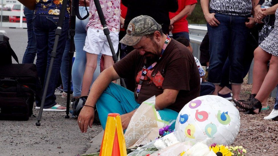 A man cries during a vigil