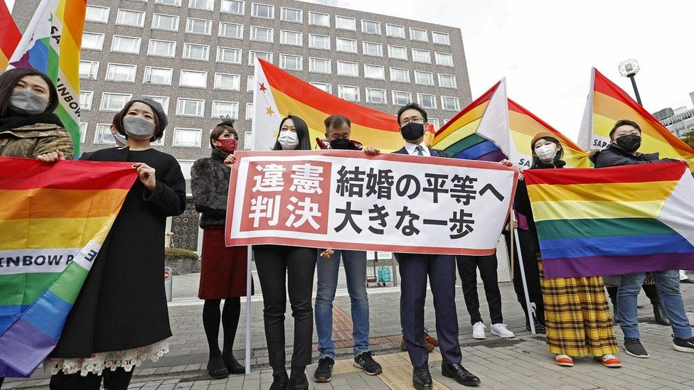 "Plaintiffs"" lawyers and supporters show a banner that reads ""Unconstitutional decision"" after a district court ruled on the legality of same-sex marriages outside Sapporo district court in Sapporo, Japan"