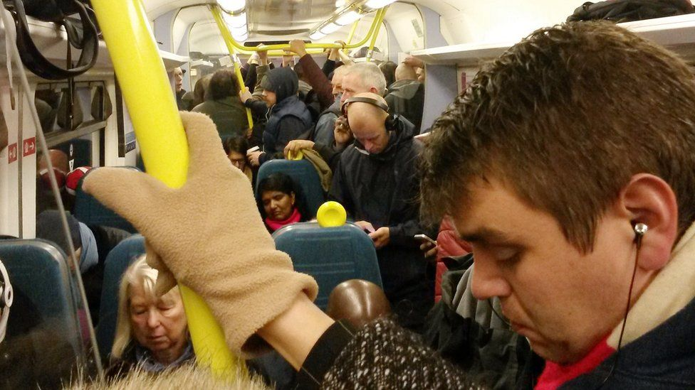 Commuters on a Southern Railway train from West Sussex to London Victoria station