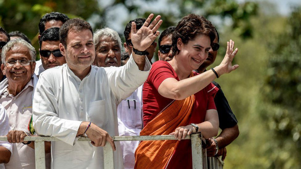 Rahul Gandhi and Priyanka Gandhi wave at the crowd in the road show after Rahul Gandhi filing nominations from Wayanad district on April 4, 2019 in Kalpetta town in Wayanand, India.