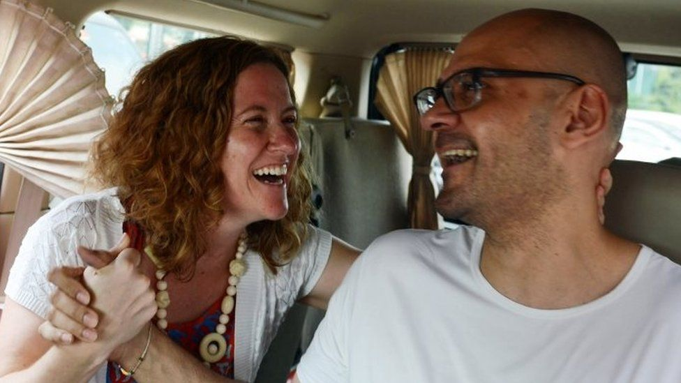 British-Canadian teacher Neil Bantleman (R) and wife Tracy Bantleman (left) after his release from Jakarta's Cipinang prison in August