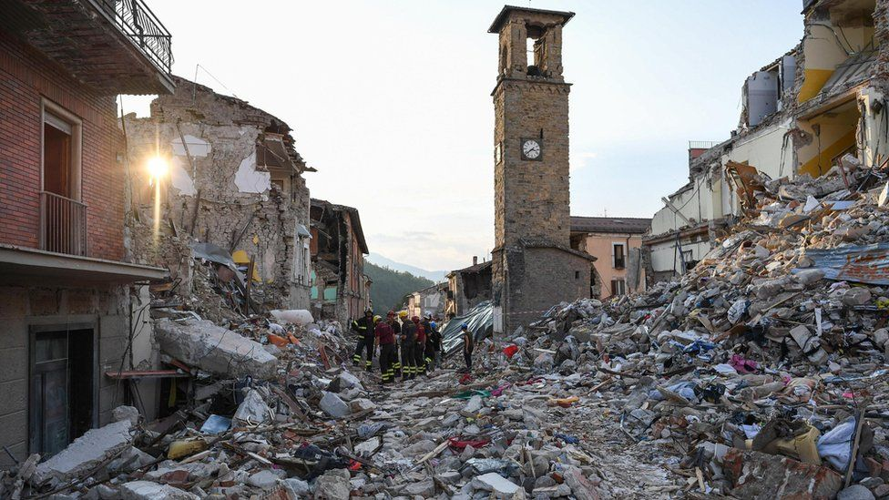Rubble as the bell tower of Amatrice stands in the background, in Amatrice, central Italy, a week after a deadly quake, on 1 September 2016