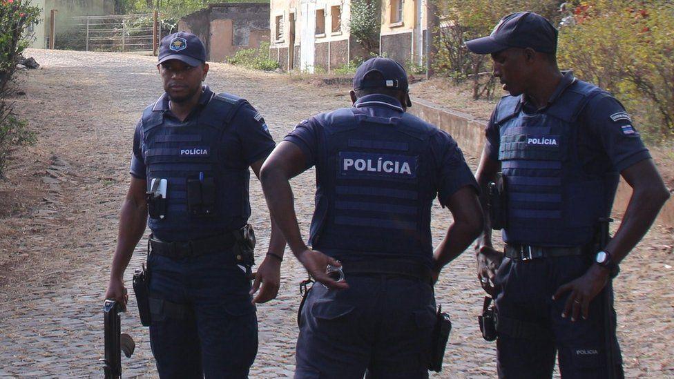 Police secure the area where 11 men were shot dead in Monte Tchota, Cape Verde - 26 April 2016