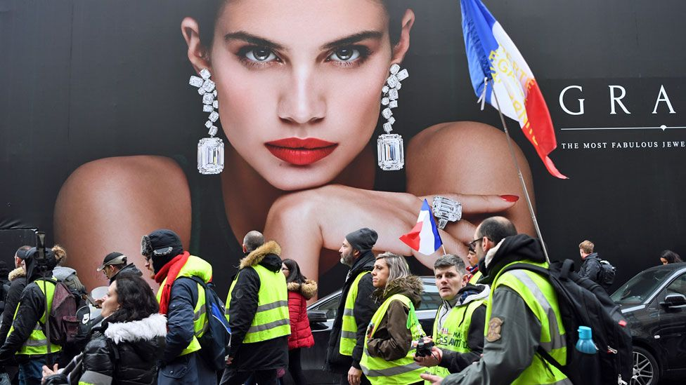 Paris protesters in front of advert