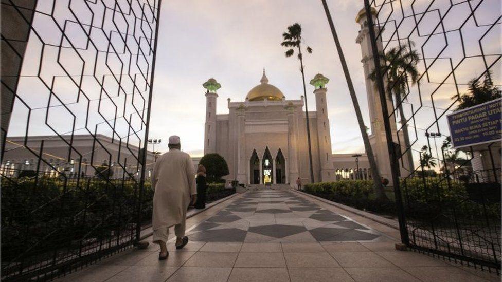 A Muslim man walks inside the Sultan Omar Ali Saifuddien mosque to perform the sunset prayer in Bandar Seri Begawan, Brunei, 1 April 2019