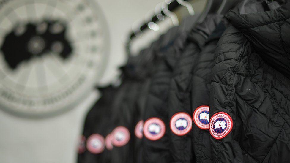 a rack of Canada goose coats