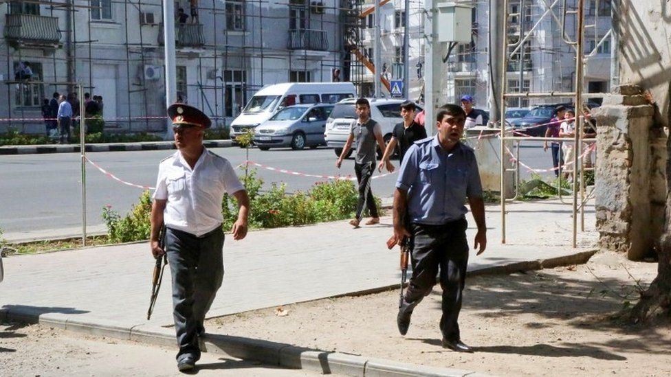 Police officers secure an area in Dushanbe where several special forces officers were shot dead on 4 September