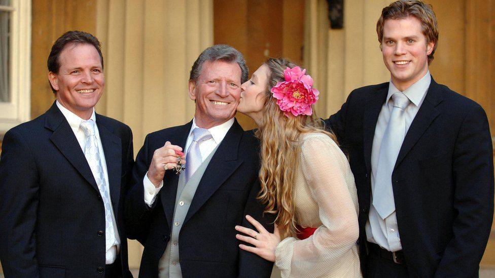 Johnny Briggs, with children (left to right) Mark, Stephanie, and Michael after collecting an MBE from the Queen at Buckingham Palace