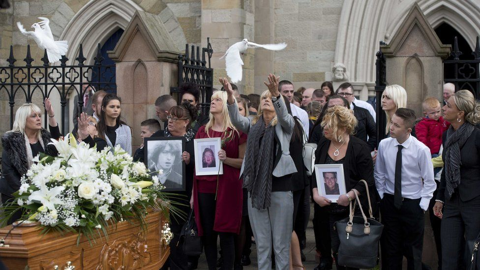 Kevin McKee's family release doves in his memory after his funeral at St Peter's Cathedral on the Fall's Road