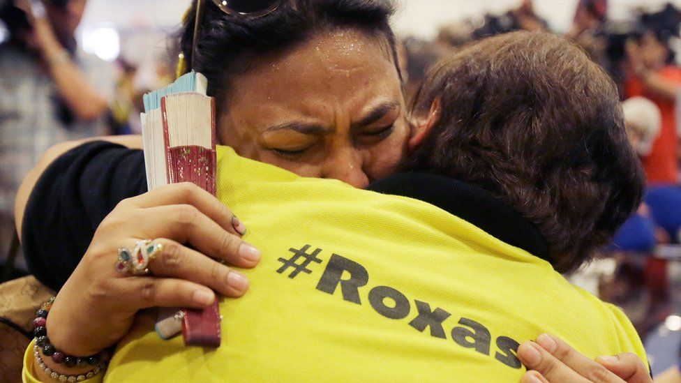 Supporters of Mar Roxas hug as he concedes defeat, at his news conference in Quezon city, Philippines, on 10 May 2016