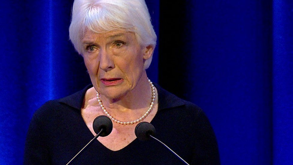 Dame Janet Smith delivering a summary of her report