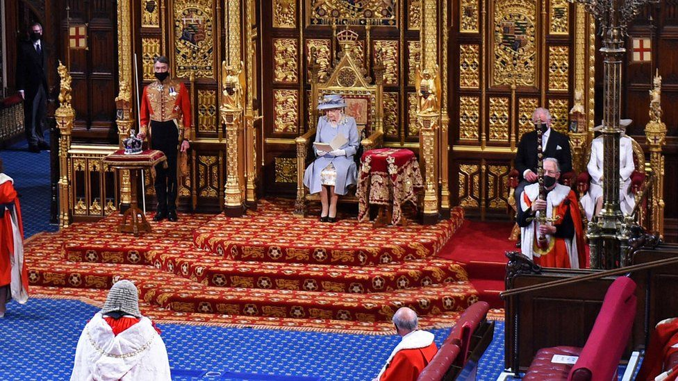 Queen Elizabeth II reads the Queen's Speech on the The Sovereign's Throne in the socially distanced House of Lords chamber