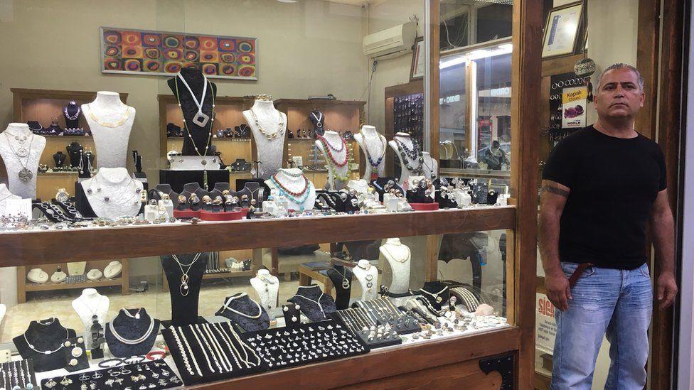 Istiklal Sevuk next to his jewellery shop