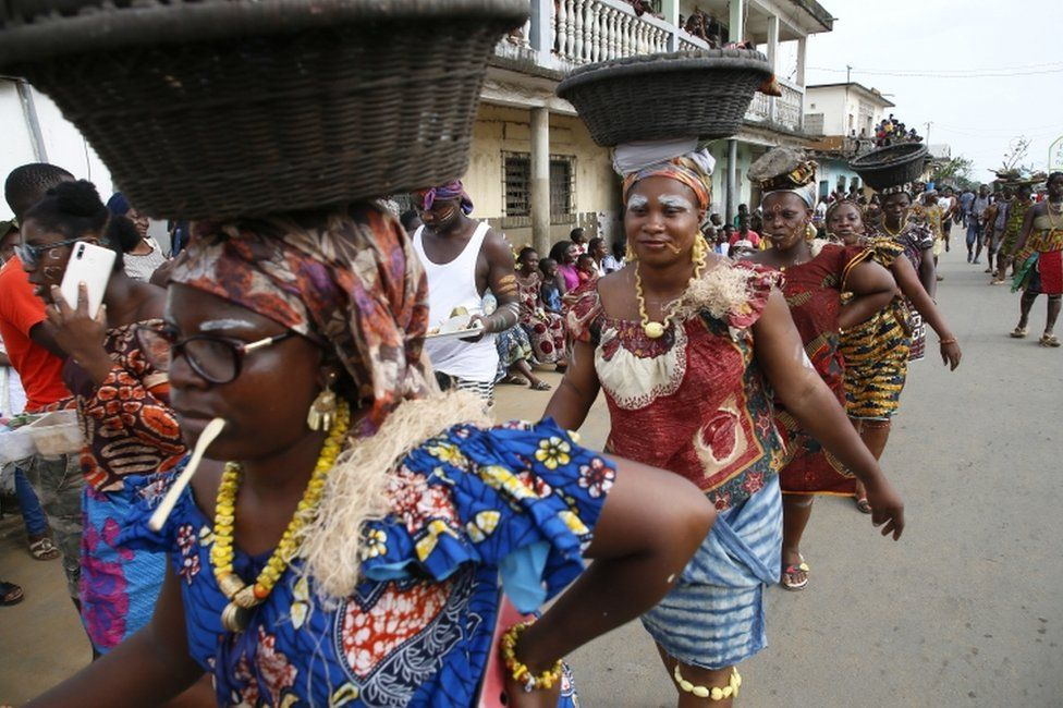 Ivorians take part in a parade on the last day of the Popo Carnival in Bonoua, south of Abidjan.