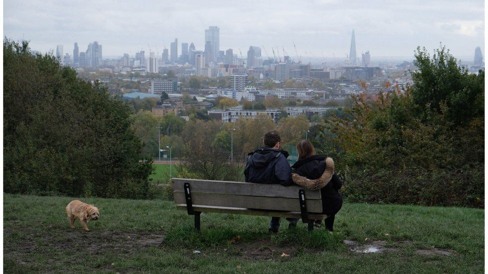 A couple take in the view at London's Parliament Hill in November 2019
