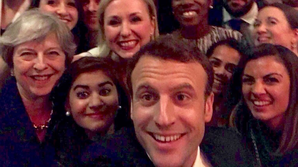 Theresa May and Emmanuel Macron pose for selfie