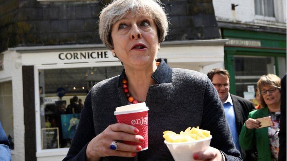 Theresa May eating chips
