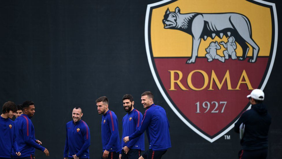 AS Roma players train in front of an uncensored club badge