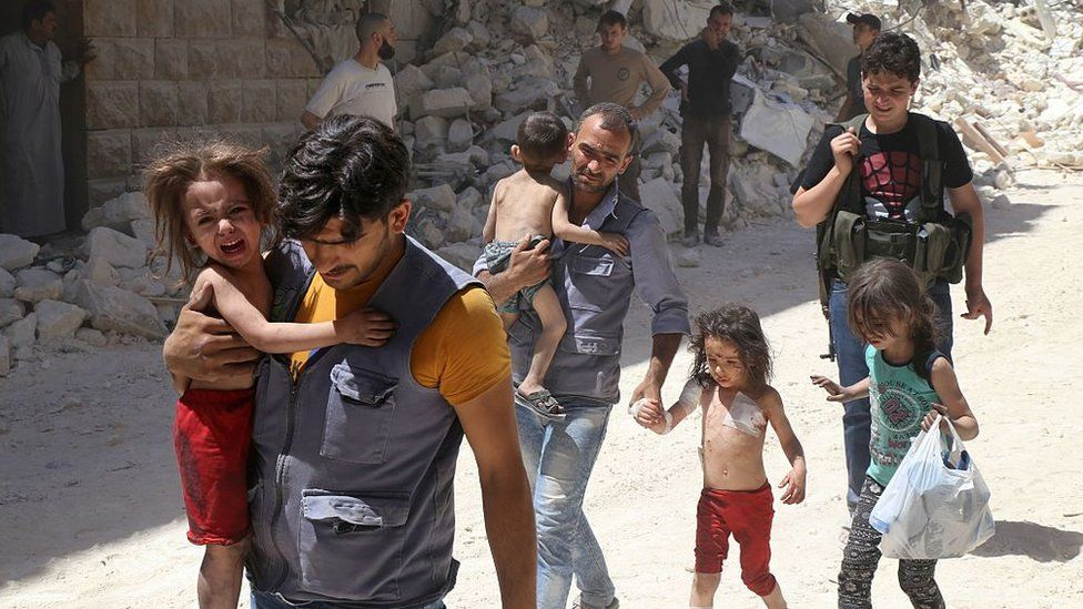 Syrians pass through eastern Aleppo (file photo)