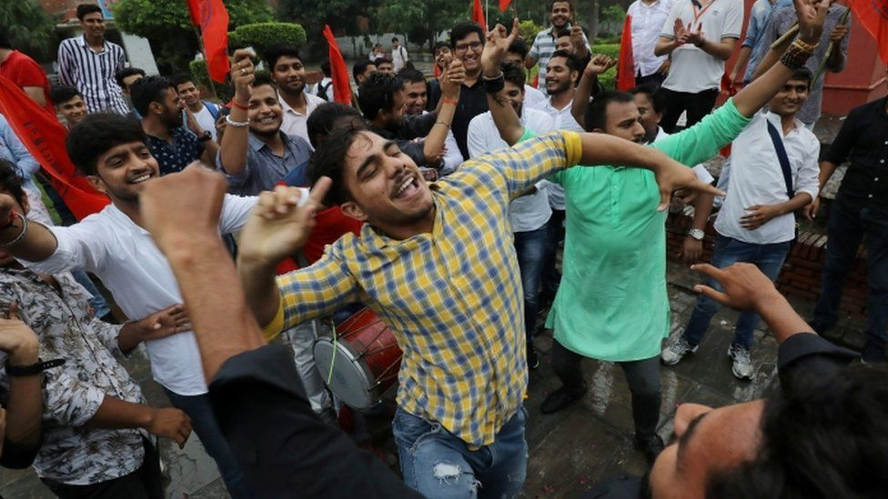 Supporters of the ruling BJP's student wing celebrate in Delhi