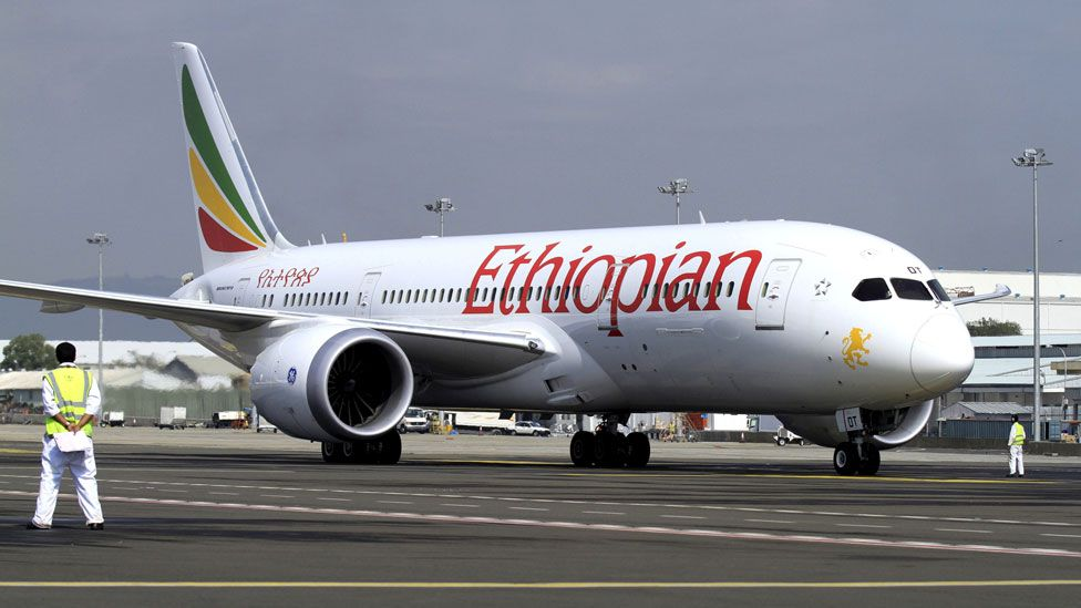 A member of the ground crew directs an Ethiopian Airlines plane at the Bole International Airport in Ethiopia's capital Addis Ababa, August 21, 2015.
