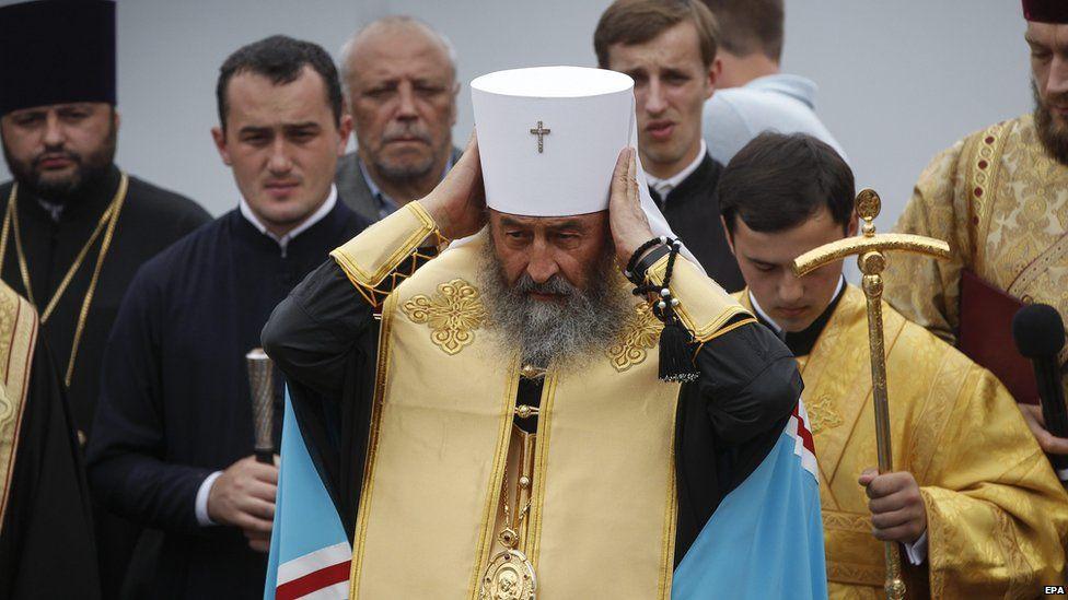 Metropolitan Onufriy (C), head of the Ukrainian Orthodox Church of Moscow Patriarchate