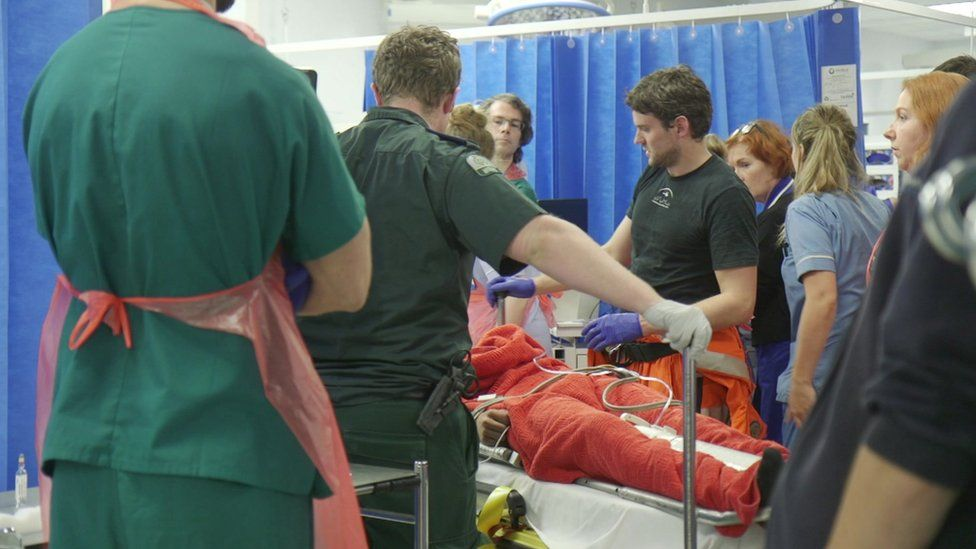 A trauma team attending a patient in the Resus unit at King' s College Hospital