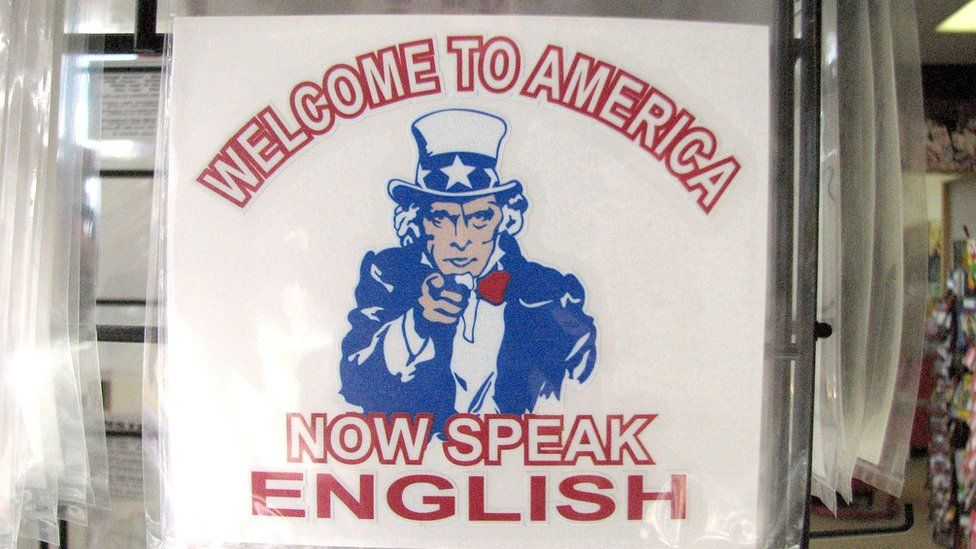 """Poster that says: """"Welcome to the USA, now speak English"""""""