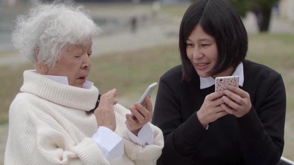 Setsuko Takamizawa is learning English through her mobile phone