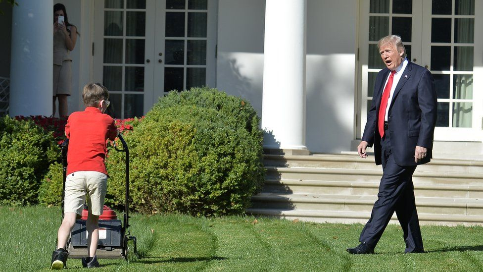 President Trump with boy mowing White House lawn