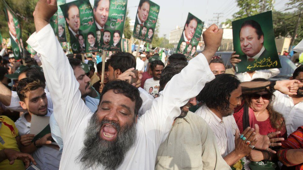 Supporters of Pakistan's Prime Minister Nawaz Sharif celebrate following the Supreme Court's decision in Lahore, Pakistan on 20 April 2017