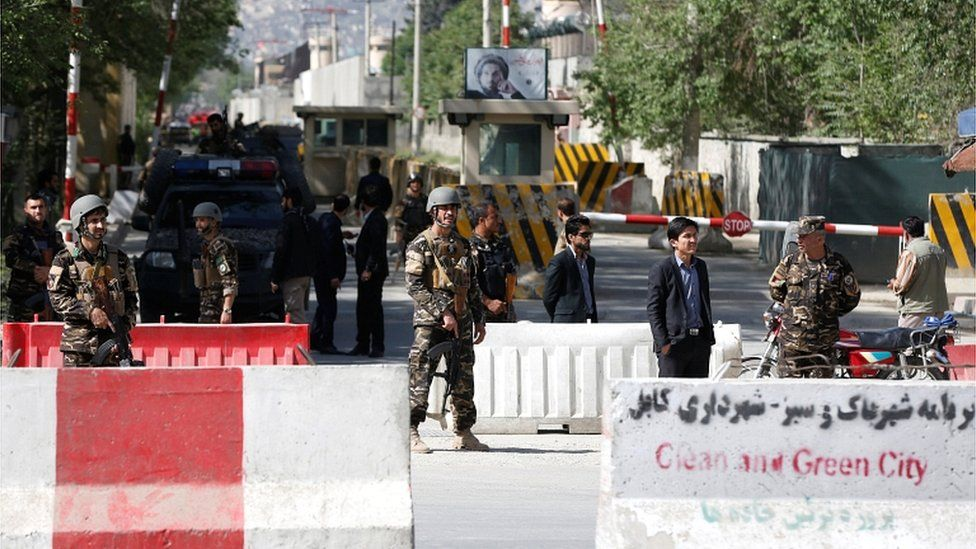Afghan security forces stand guard near the site of a blast in Kabul on 30 April 2018
