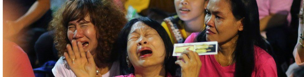 Thai people react and mourn as they hear the news of the death of Thai King Bhumibol Adulyadej outside Siriraj Hospital in Bangkok, Thailand, 13 October 2016.