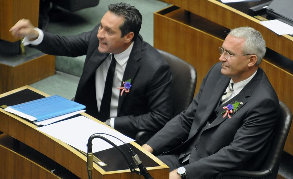 Austrian Freedom Party members Heinz Christian Strache and Martin Graf wear cornflowers in the Austrian parliament in 2008