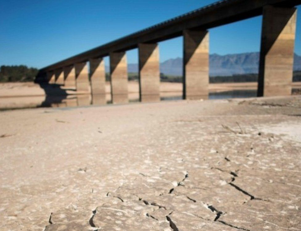 A picture taken on May 10, 2017 shows dry cracked mud staring out at the sky at Theewaterskloof Dam