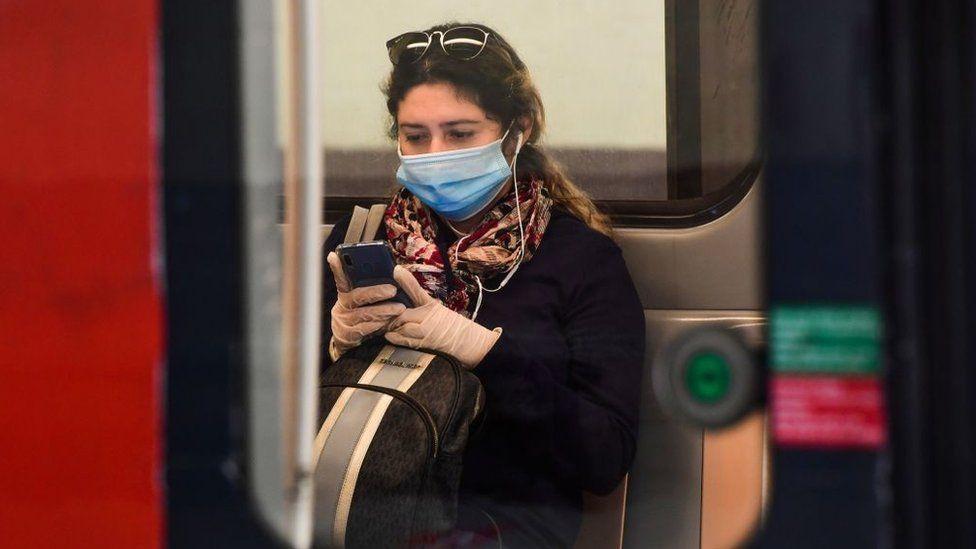 woman on phone on train