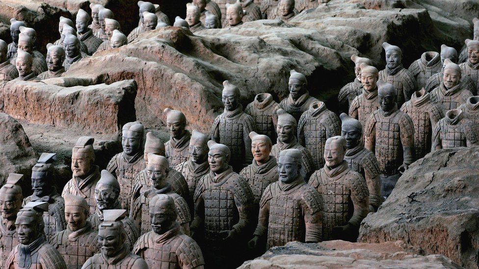 Ancient terracotta warriors stand in a pit at the Emperor Qin's Terracotta Warriors and Horses Museum on July 7, 2006
