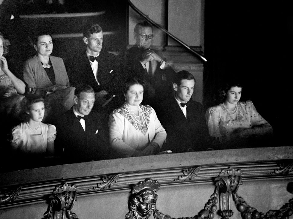 Princess Margaret, King George VI, Queen Elizabeth, Group Captain Peter Townsend and Princess Elizabeth in the Royal Box at the Strand Theatre (August 1946)