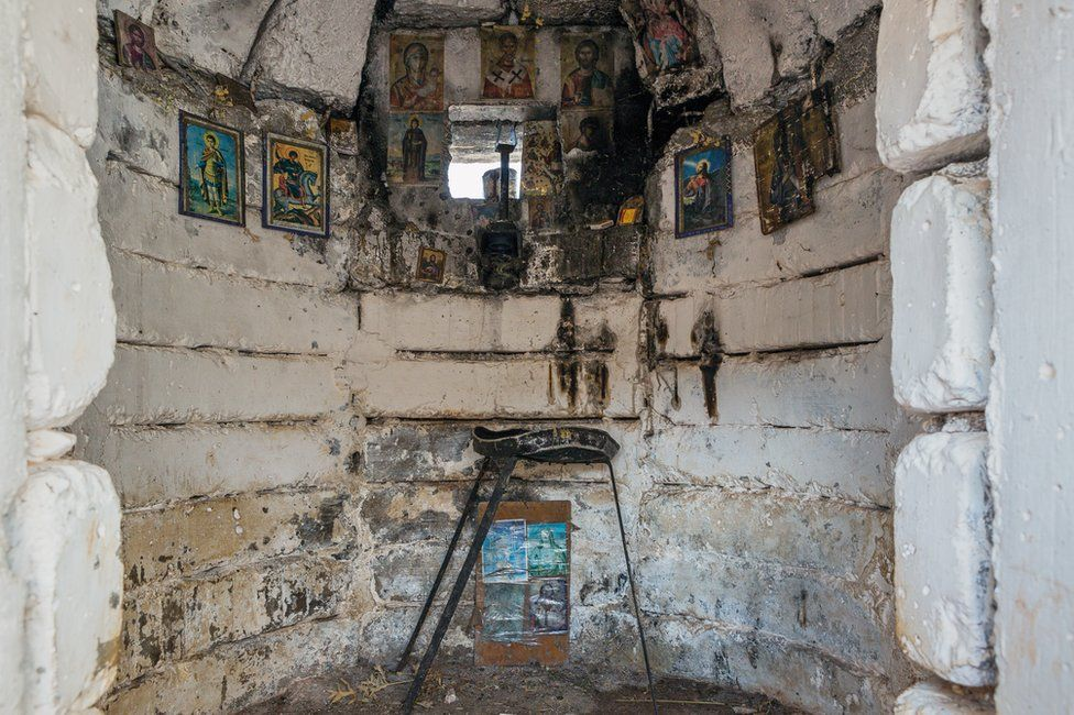 Interior view of a bunker in Albania with religious paintings