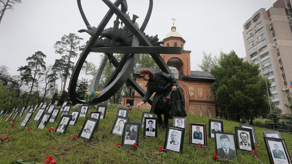 Photos of the victims laid out in Kiev on 26 April 2016