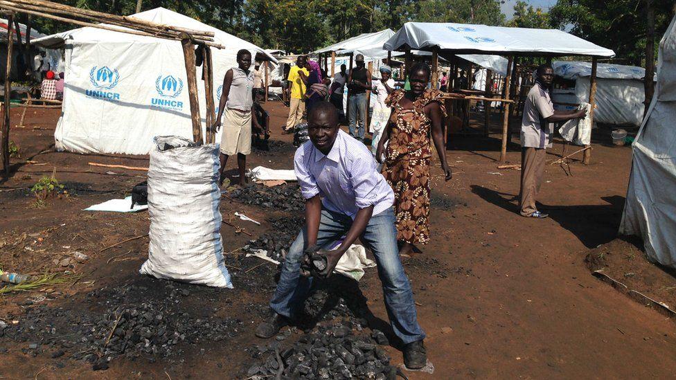 Abdul Karim Ali selling charcoal in the market