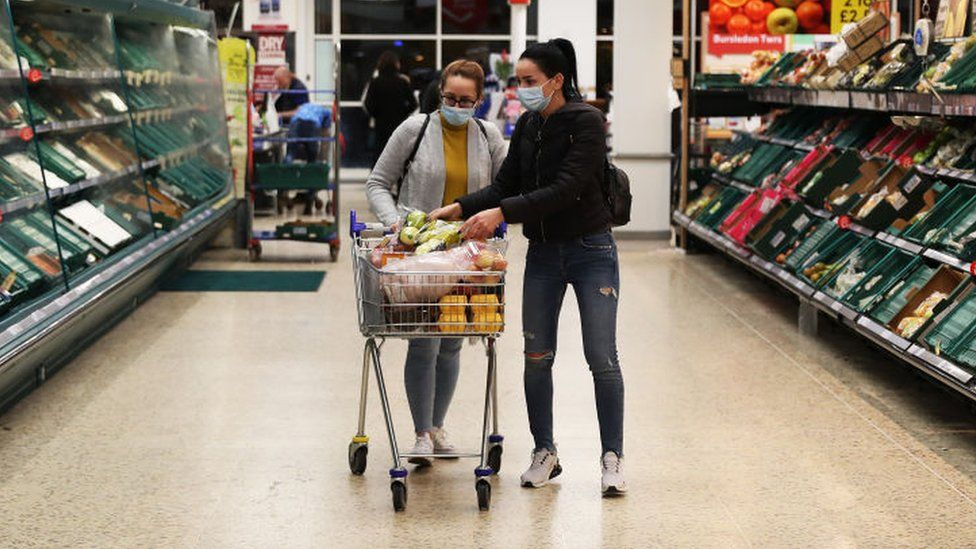 Tesco shoppers wearing face masks