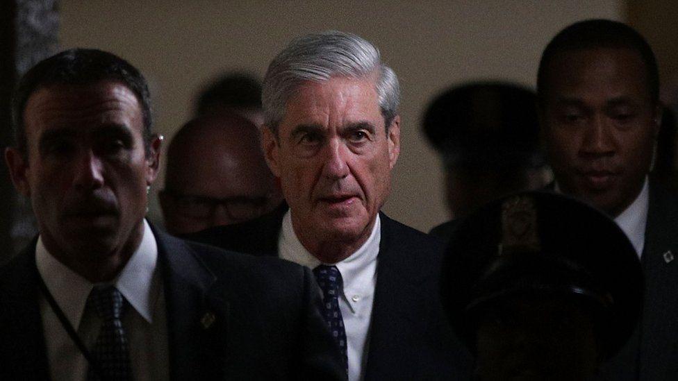 Robert Mueller walks through the halls of Congress.