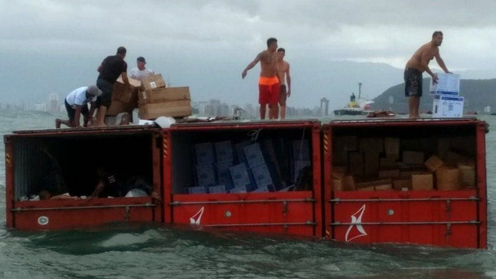 Police photo showing people looting containers from Log-In Pantanal off the coast of Santos, Sao Paulo state, Brazil