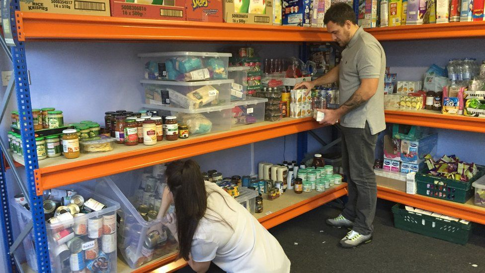 Laura and Tom organising the food bank