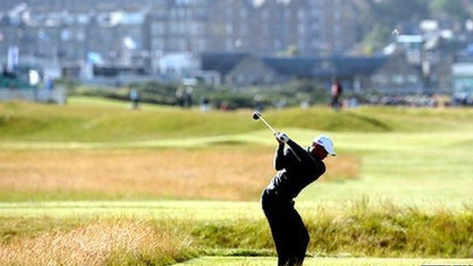 Woods playing on the course at St Andrews