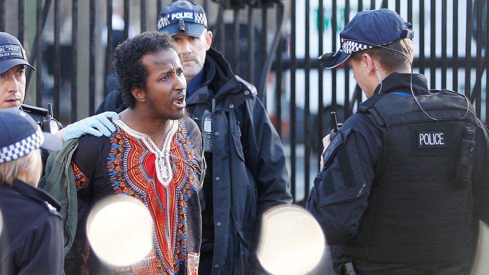 Armed police detain man