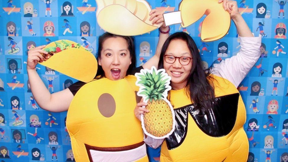 Yiying and Irene dressed as emoji