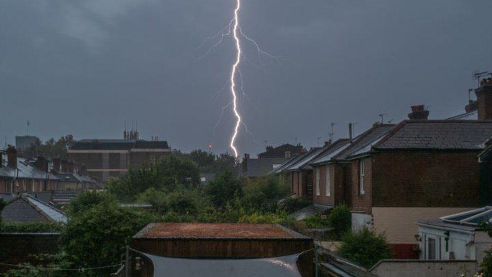 Lightning over Winchester rooftops